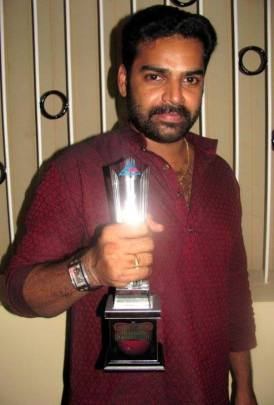 Pradeep Chandran with his Award