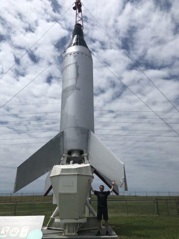 Standing under a mock up of the Little Joe rocket