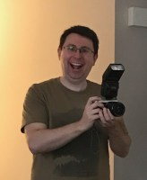 exuberant keith holding his camera and flash