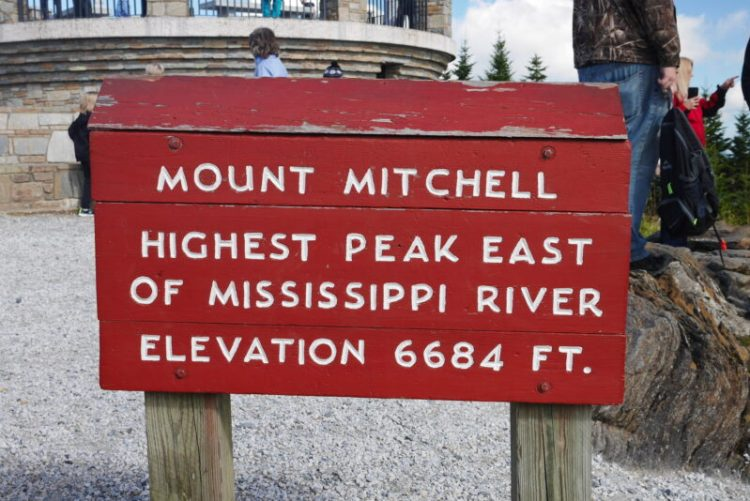 "Sign reading ""Mount Mitchell - Highest Peak East of the Mississippi River, Elevation 6684 ft"""