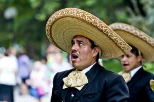 Mexican with sombrero hat singing