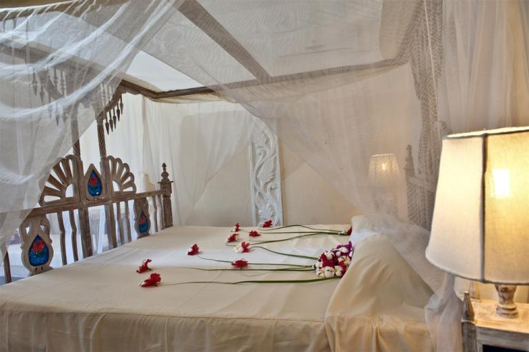 A room at Jacaranda Beach Hotel