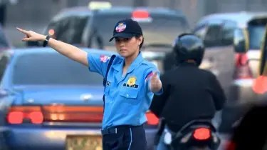 Lara Quigaman as traffic enforcer in I DARE YOU