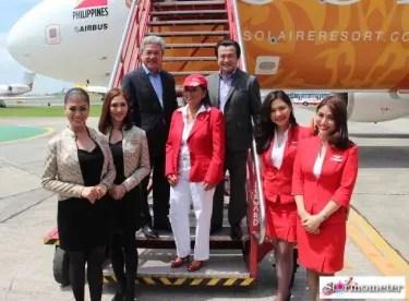 Mr. Donato Almeda, Ms. Maan Hontiveros, and Mr. Jasper Evangelista with AirAsia flight attendants.