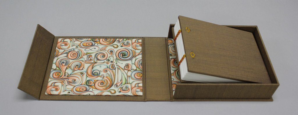 Custom coptic stitch bound book and drop-spine folio box