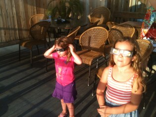 Kalen and Piper with eclipse glasses on