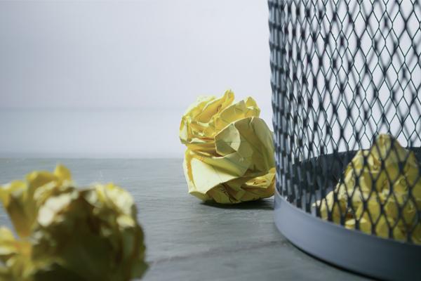 garbage paper outside a bin