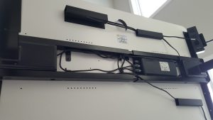 underside of mojodesk with wire management guides