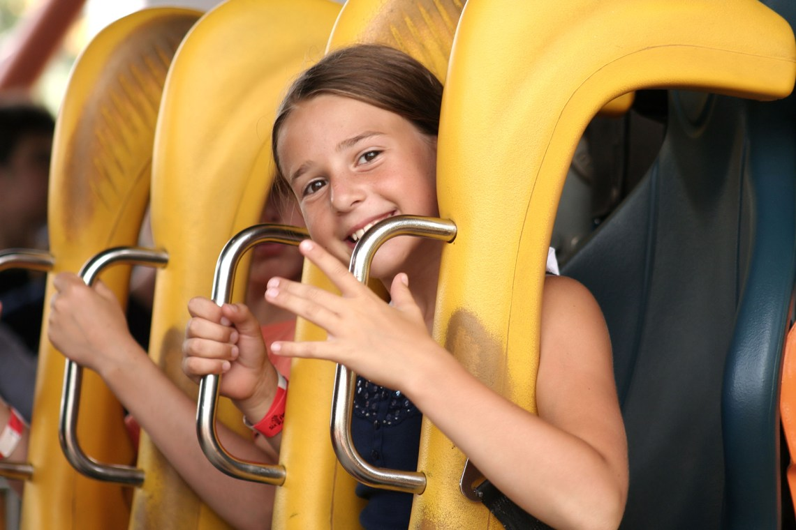 dining opportunity cute girl riding on a roller coaster