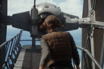 Jyn is approaching a TIE Fighter at high altitude. The question is, does this TIE stop her, or does Bodhi sit behind the sticks to pick her up.