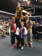 Troops 40429 and 41123 meet the Nittany Lion at the Lady Lion's Scout Day.