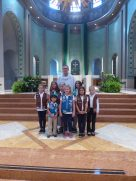 Girls from Troop 40170 receive their Catholic Scouting Emblems from the Bishop