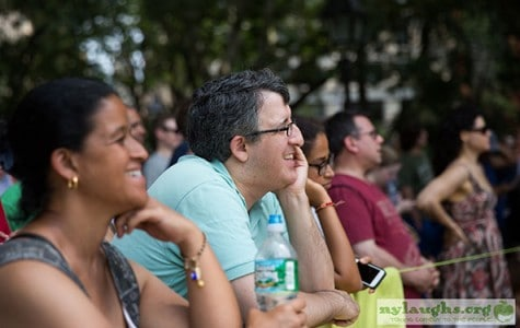 guests in the park laugh during a stand-up comedy performance