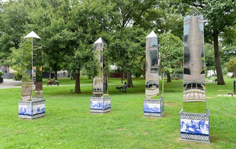 mirror obelisks in a park