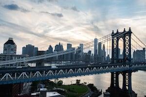 Manhattan Bridge with the NYC skyline behind it