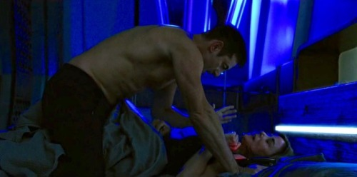 a screen cap of Lorca and Cornwell in bed