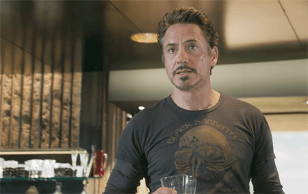 a screen cap from the Avengers of Tony Stark in a Black Sabbath t-shirt