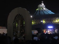 Pilgrim carries Virgin shrine into the Basilica of Our Lady of Guadalupe. Source: Chris Crews (Attribution via chriscrews.com)