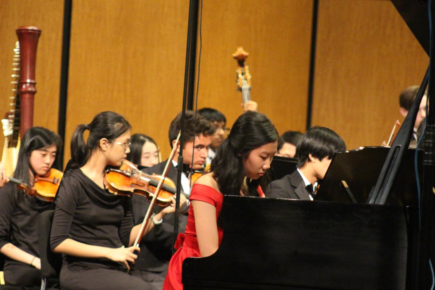 Stephanie Li '19 performs a piano concerto while the rest of Patriot Orchestra plays along. Future soloists will include Adele Lee '19 and Reid Harmon '19.