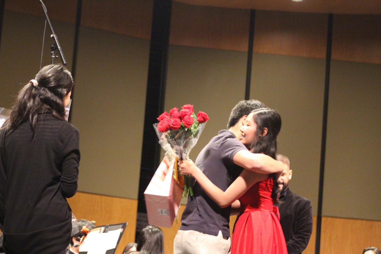 Michael Hu '19 congratulates Stephenie Li '19 on her performance. Li was the soloist, and performed Ravel's Piano Concerto in G Major, Movement No. 1