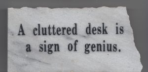 cluttered desk sign