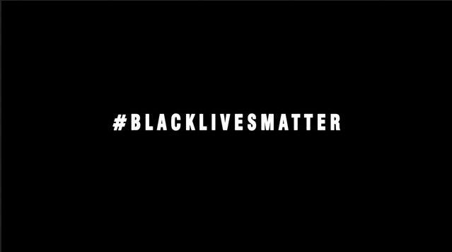 The image shows a black rectangle with the following written in white capital letters across the middle: '#BlackLivesMatter'