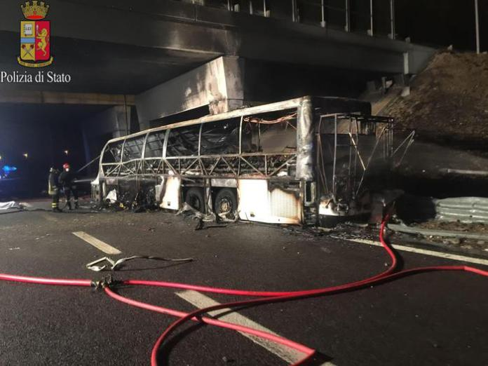 A handout photo made available by Polizia (Police) shows a burned Hungarian bus after an accident at 'Verona Est' highway's exit in Verona, Italy, 21 January 2017. ANSA/POLIZIA EDITORIAL USE ONLY