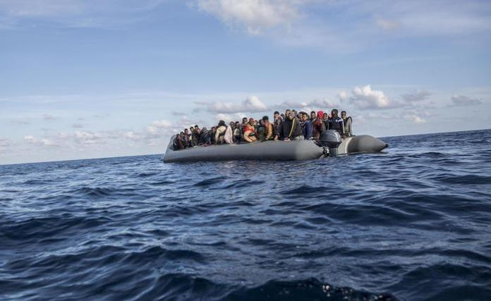 In this Friday, Dec. 21, 2018, photo, migrants sit in a rubber dinghy after Proactiva Open Arms, a Spanish NGO, spotted and rescued them in the Central Mediterranean Sea at 45 miles (72 kilometers) from Al Khums, Lybia. The Spanish NGO Open Arms have rescued about 300 migrants from 3 boats crossing the Mediterranean from North Africa to Europe on Friday. (ANSA/AP Photo/Olmo Calvo) [CopyrightNotice: Copyright 2018 The Associated Press. All rights reserved.]