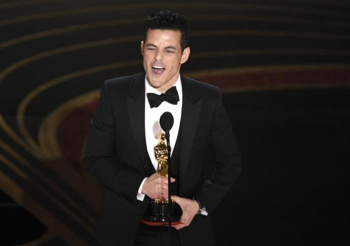 Rami Malek accepts the award for best performance by an actor in a leading role for