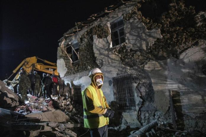 Rescuers search a collapsed building after a magnitude 6.4 earthquake in Thumane, western Albania, Tuesday, Nov. 26, 2019. Rescue crews with excavators searched for survivors trapped in toppled apartment buildings and hotels Tuesday as the death toll from a powerful pre-dawn earthquake in Albania climbed to 21, with more than 600 people injured. (ANSA/AP Photo/Petros Giannakouris) [CopyrightNotice: Copyright 2019 The Associated Press. All rights reserved]