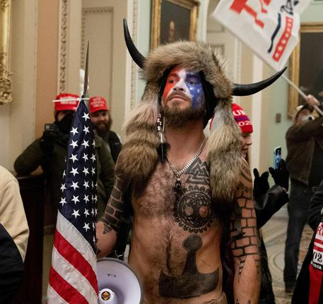 Supporters of US President Donald Trump protest in the US Capitol on January 6, 2021, in Washington, DC. - Demonstrators breeched security and entered the Capitol as Congress debated the a 2020 presidential election Electoral Vote Certification. (Photo by SAUL LOEB / AFP)