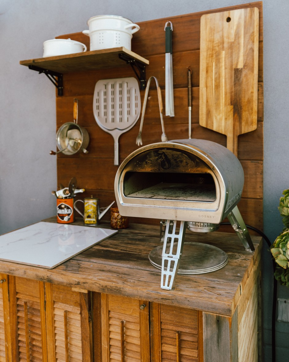 Rustic outdoor kitchen with pizza oven
