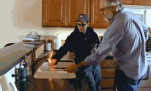 "A man lights his tap water on fire to demonstrate pollution from natural gas ""fracking"""