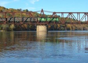 An Osceola & St. Croix Valley train crosses the St. Croix River on the Cedar Bend Bridge