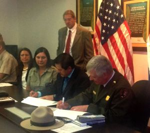 SINAC Executive Director Rafael Guitiérrez, center, Christopher Stein, right, superintendent of St. Croix National Scenic Riverway in the U.S., and Osa Conservation Area Director Etilma Morales sign a sister park agreement between the Osa Conservation Area and the national parks of the upper Midwest of the United States. (Photo by Judy Freund, Rotary District 5960)