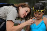 WRSP Naturalist Kacie Carlson and a young acolyte.