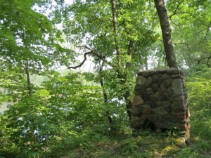 Old stone fireplace still standing at the landing