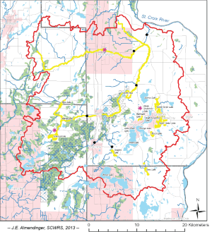 The watershed (red boundary) of the Sunrise River, a major tributary to the St. Croix on the Minnesota side, showing impaired waters (river segments and lakes) in yellow.  Many of these impairments are related to excess phosphorus.