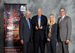 Peter Gove receives the Marjory Stoneman Douglas Award. Pictured from left to right: Bill Walter, National Board Trustee for NPCA; Peter Gove, Chair of NPCA's Upper Midwest Regional Council; Christine Goepfert, NPCA's Upper Midwest Program Manager; and Clark Bunting, President and CEO of NPCA. Photo Credit: Eric Miller