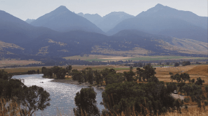 A scene of the Yellowstone River and mountains