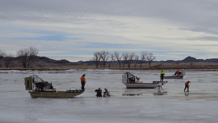 Oil recovery workers  on the Yellowstone River in January 2015.