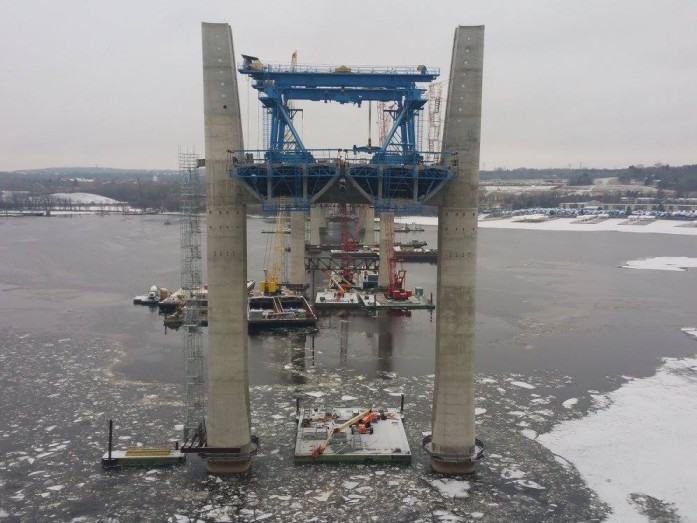View of Pier 12, closest to Wisc. land. Tug boats are breaking ice within the bridge construction zone and downstream near Bayport to keep the waterway open. Crews can only access Piers 10 and 11 in the middle of the river by boat. Tower construction continues at these pier locations.