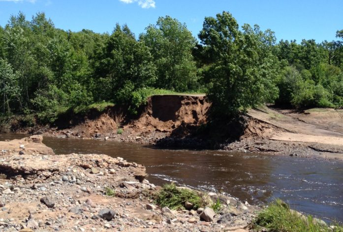 The Totogatic River found a new route out of the Colton Flowage – through the road. (Photo by Joyce Palucci)