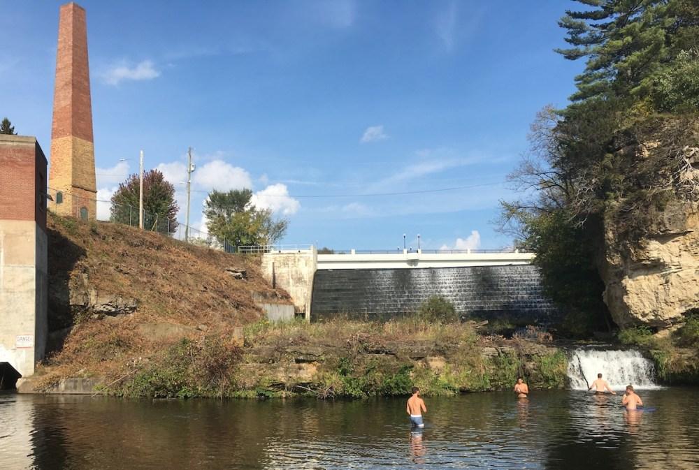 Children swimming below a dam in River Falls, Wisconsin