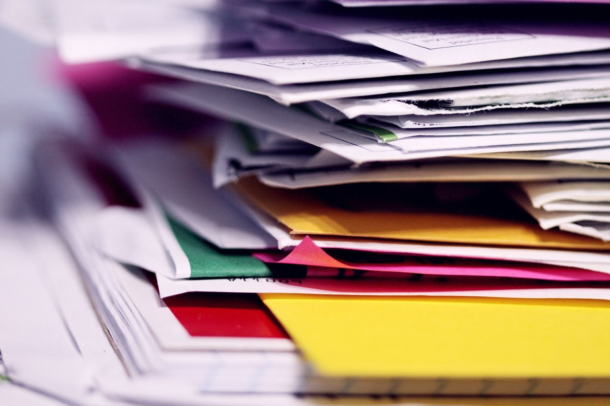 Pile of direct mail that is counter to a guide to green marketing