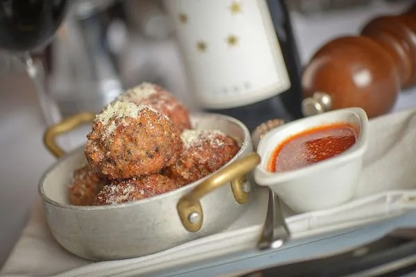 Meatballs in a pan covered in cheese