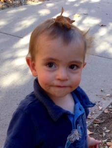 Baby Prince Charming sporting his leaf helmet.