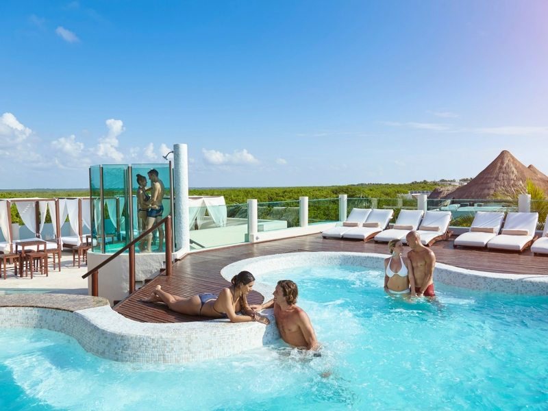 Desire Riviera Maya Resort Rooftop Hot Tub. We have spent quite a bit of time in Desire's hot tub. In the early evening it is mainly a social event where other couples talk and flirt with each other. The hot tub does get pretty wild later at night.