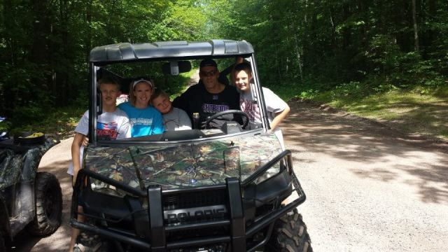 Great family time together riding ATV's by the cabin near Tomahawk.