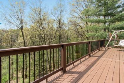 Large deck across the side of the house made using durable and low maintenance material